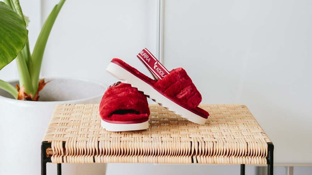 Close up of the Fuzz'n sandals in red.